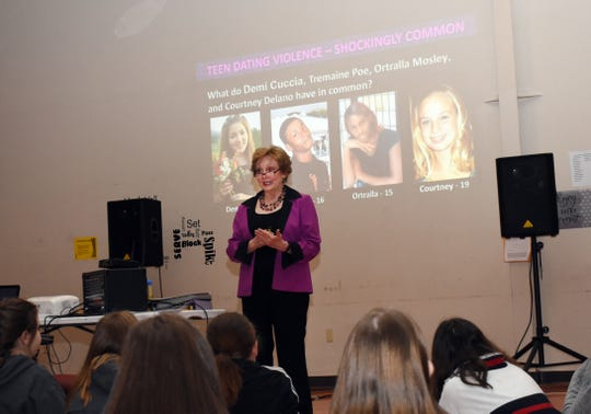 Carolyne Hoyt, executive director of NextSTEP of Central Louisiana, speaks to Pineville Junior High School students about dating violence. NextSTEP teaches teens and young adults to recognizes signs and what to do if they encounter dating violence.