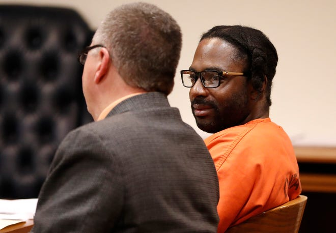 Willie G. Allison looks over to his attorney John H. Wallace, III during his sentencing on three counts of human trafficking, second degree reckless injury, two counts of manufacturing or delivering heroin and maintaining a drug trafficking place Monday at the Outagamie County Justice Center in Appleton.