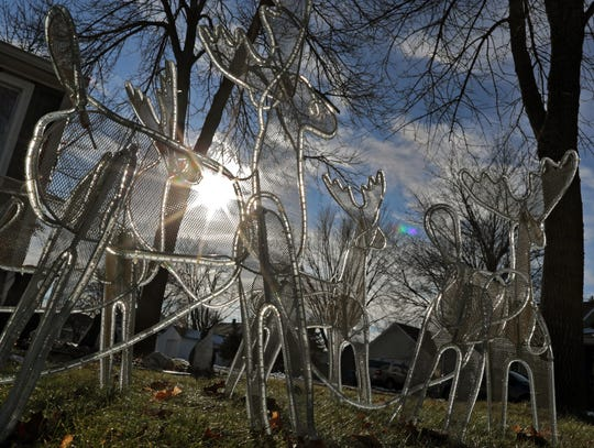 The sun shines through Christmas decorations Tuesday afternoon on Lincoln Avenue in Little Chute.