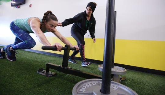 Michelle Miraglia-Scutti, right, owner of Superior Fitness in Toms River, works with Stephanie Lauren.