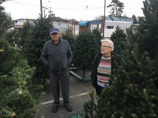 Ted and Mary Lough of Brick shopping for a Christmas tree at the Nature's Reward Farm Market in Point Pleasant on Dec. 17, 2018.