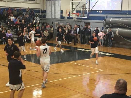 Manasquan's Xander Korolik (22) gets ready to shoot in warmups as the Warriors prepared to face visiting Rumson-Fair Haven on Dec. 17, 2018