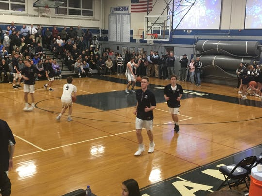 The Manasquan boys basketball team wraps up prior to its game against visiting Rumson-Fair Haven on Dec. 17, 2018.