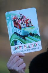 Sandra Morelli of Marlboro, who experienced a harness malfunction aboard Kingda Ka at Great Adventure last August, tells her story at her home in Marlboro, NJ Tuesday, December 18, 2018.  She created holiday cards featuring herself riding a roller coaster with a broken harness with her family.