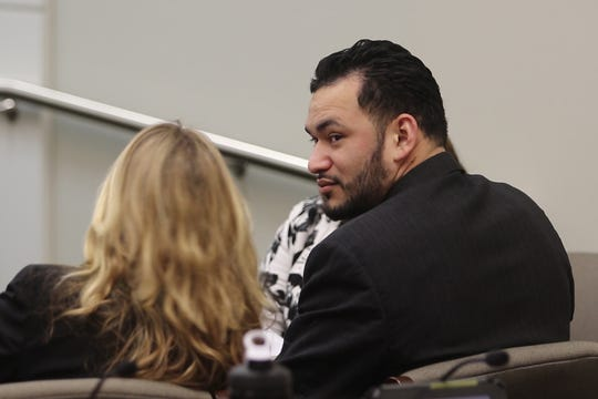 Carlos I. Menjivar of Long Branch listens to closing arguments at the end of his trial before Superior Court Judge David F. Bauman at the Monmouth County Courthouse in Freehold on Dec. 12.