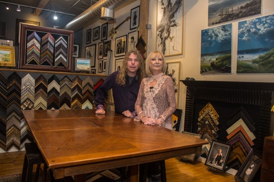Owners Megan Prederville and Mike Harper of Frame to Please in Red Bank specialize in custom framing and art dealing.