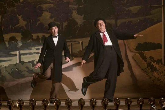 "Steve Coogan as Stan Laurel, left, and John C. Reilly as Oliver Hardy in a scene from ""Stan and Ollie."""