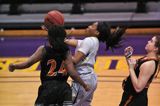 Hardin-Simmons guard Taylor Gaffney (10) goes under a Texas-Dallas defender for a basket at the Mabee Complex in Abilene on Tuesday, Dec. 18, 2018. The Cowgirls will now be off until Jan. 3 at LeTourneau.