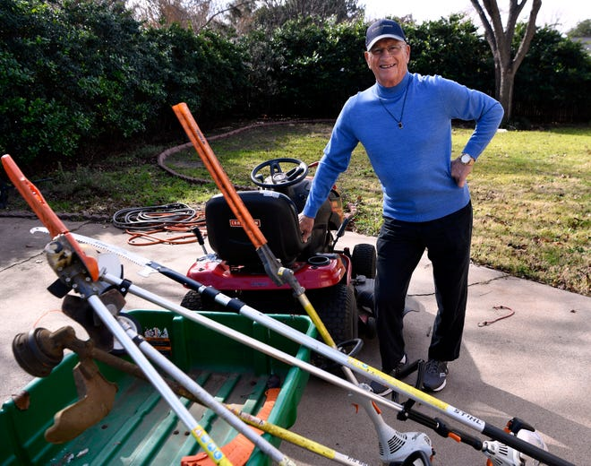 Roy Dent with his tools in the backyard at his Abilene home.