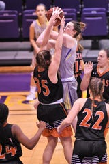 Hardin-Simmons' Keilee Burke (11) goes up for a shot over a Texas-Dallas defender at the Mabee Complex in Abilene on Tuesday, Dec. 18, 2018. The Cowgirls will now be off until Jan. 3 at LeTourneau.