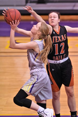Hardin-Simmons' Karlea Ritchie (14) goes up for a shot against Texas-Dallas at the Mabee Complex in Abilene on Tuesday, Dec. 18, 2018. The Cowgirls will now be off until Jan. 3 at LeTourneau.