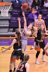 HSU's Samantha Newton (20) goes over Texas-Dallas' Amber Terry (12) for a shot at the Mabee Complex in Abilene on Tuesday, Dec. 18, 2018. The Cowgirls will now be off until Jan. 3 at LeTourneau.