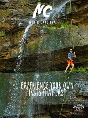 One of three covers to the just-released tourism guide to North Carolina features rappelling in Polk County.