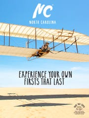 One of three covers to the just-released tourism guide to North Carolina features hang-gliding on the Outer Banks.