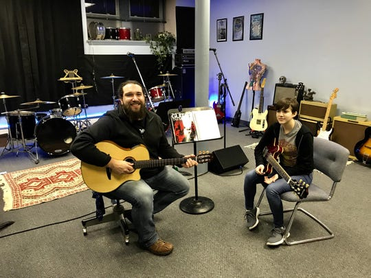 Music teacher Nate Gross offers lessons to students like Cat Jennings of Norwich from a studio space in the city at the Chenango Arts Council.