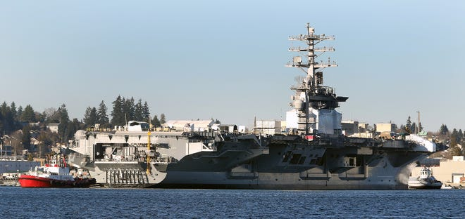 The USS Nimitz at the Puget Sound Naval Shipyard in December. The carrier is currently in San Diego, and a 21-year-old sailor was reported by the Navy to have died on Saturday after a fall aboard the carrier.