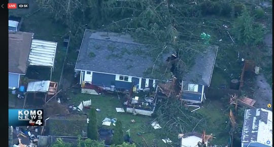 Trees ripped through the roofs of homes in Port Orchard following a tornado that ripped through the area just before 2 p.m., according to this video gathered by KOMO.