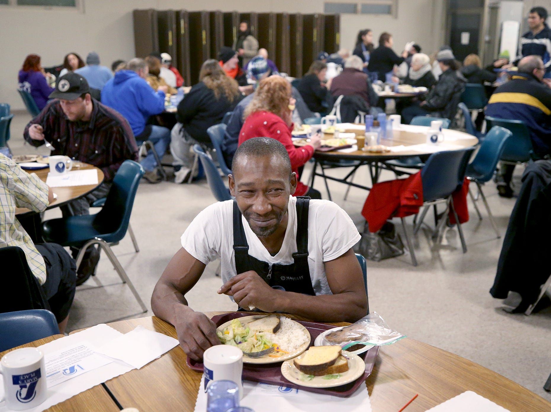 Lashon Little enjoys a hot meal at Mary's Place, a free meal for the homeless and hungry at Our Lady Star of the Sea Catholic Church in Bremerton. The meal is every Monday evening in Camerman Hall in the basement of the church. The meal has been in operation for four years.