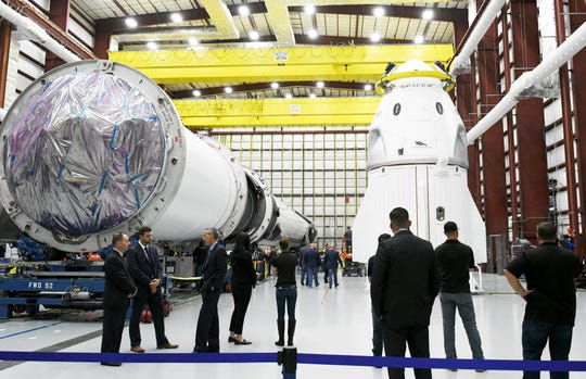 SpaceX's Crew Dragon capsule sits in a hangar at Kennedy Space Center next to the Falcon 9 booster slated to launch Demonstration Mission 1 for NASA's Commercial Crew Program. The uncrewed test flight to the ISS is now targeting launch from KSC on March 2, 2019.