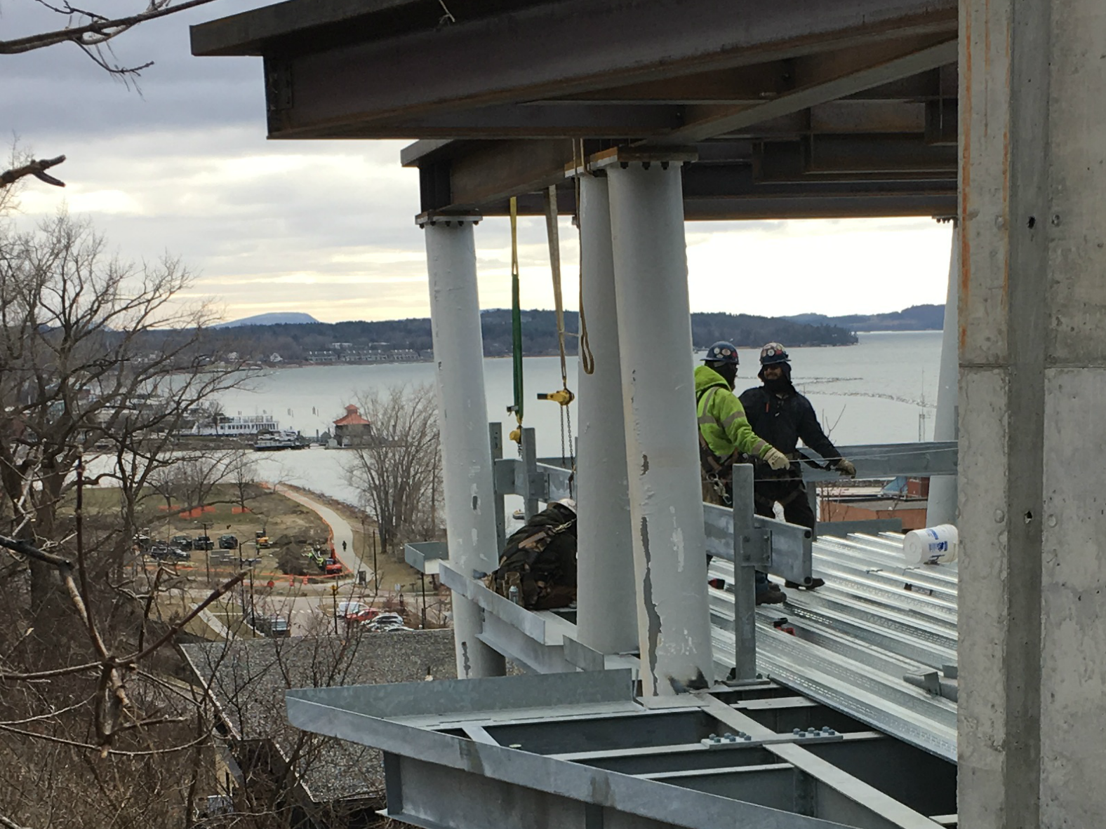 "Workers install steel decking on what will be the parking garage for the ""One Lakeview"" building overlooking Lake Champlain in Burlington. Photographed Dec. 18, 2018."