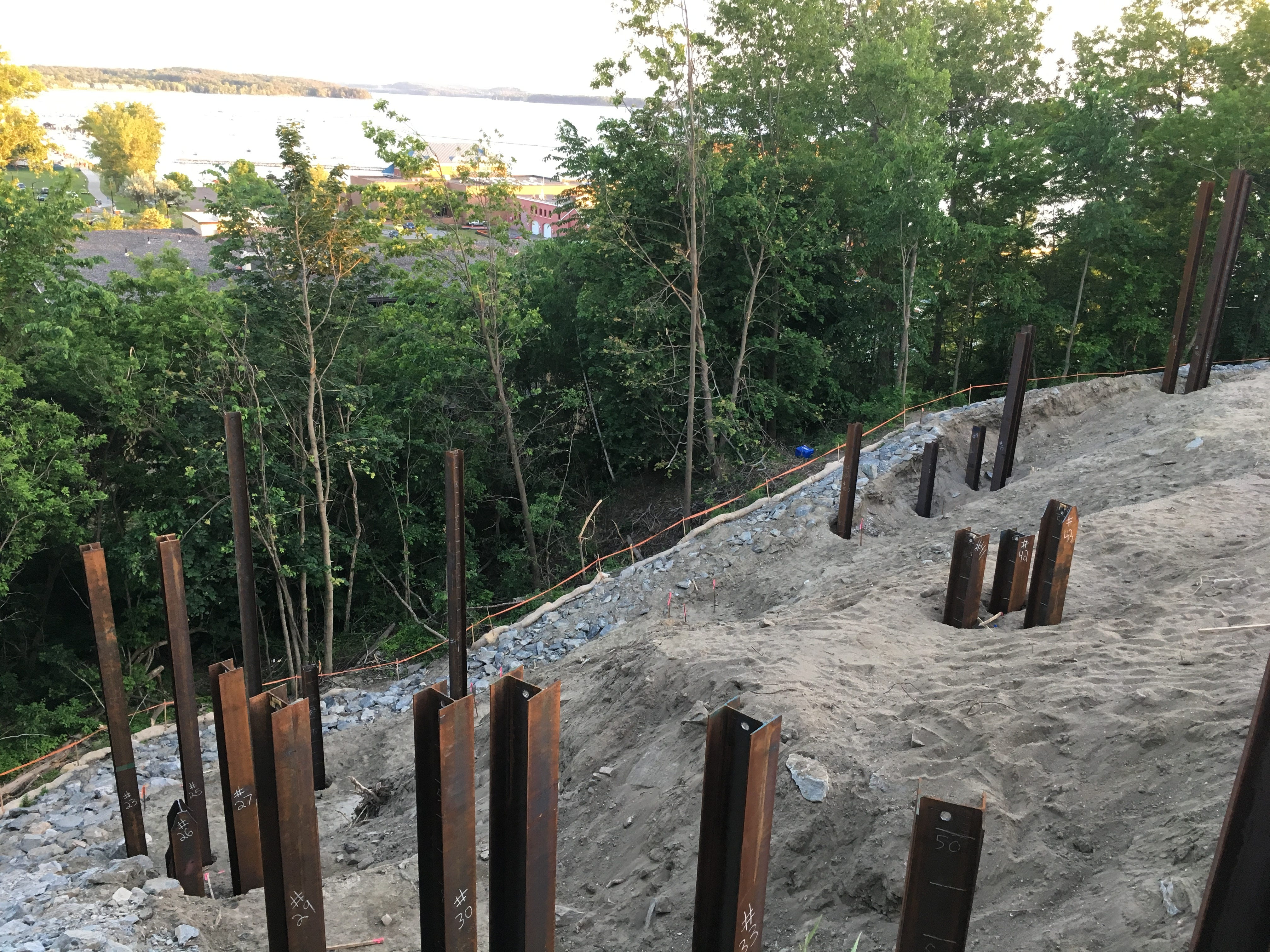 "Steel pilings, some of them reaching down 80 feet to bedrock, protrude from a hillside above Burlington's waterfront as the foundation supports for a new building's ""piers."" Photographed on June 9, 2018."