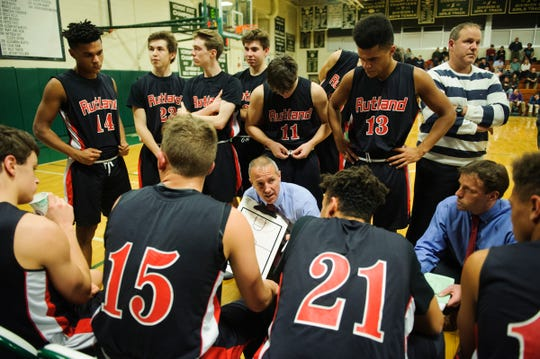 Rutland head coach Michael Wood talks to the team during a time out in the boys basketball game between the Rutland Raiders and the Rice Green Knights at Rice Memorial High School on Monday night December 17, 2018 in South Burlington.