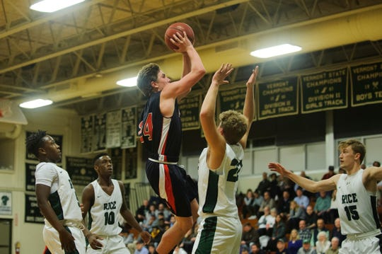 Rutland's Jacob Lorman (24) leaps to take a shot during the boys basketball game between the Rutland Raiders and the Rice Green Knights at Rice Memorial High School on Monday night December 17, 2018 in South Burlington.