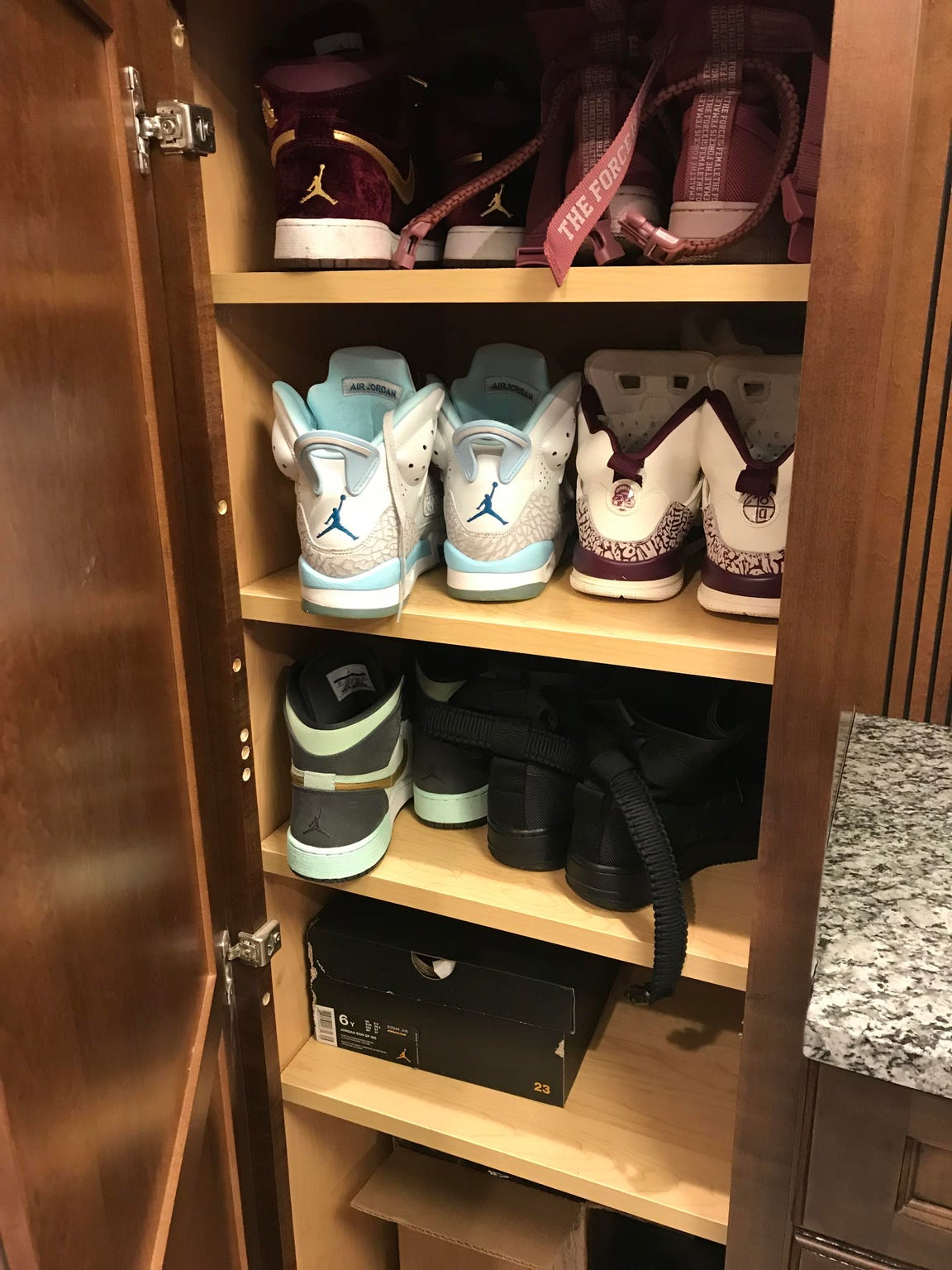 """Megan Incerto runs LUX Beauty Shop and keeps a stash of """"work shoes"""" handy."""