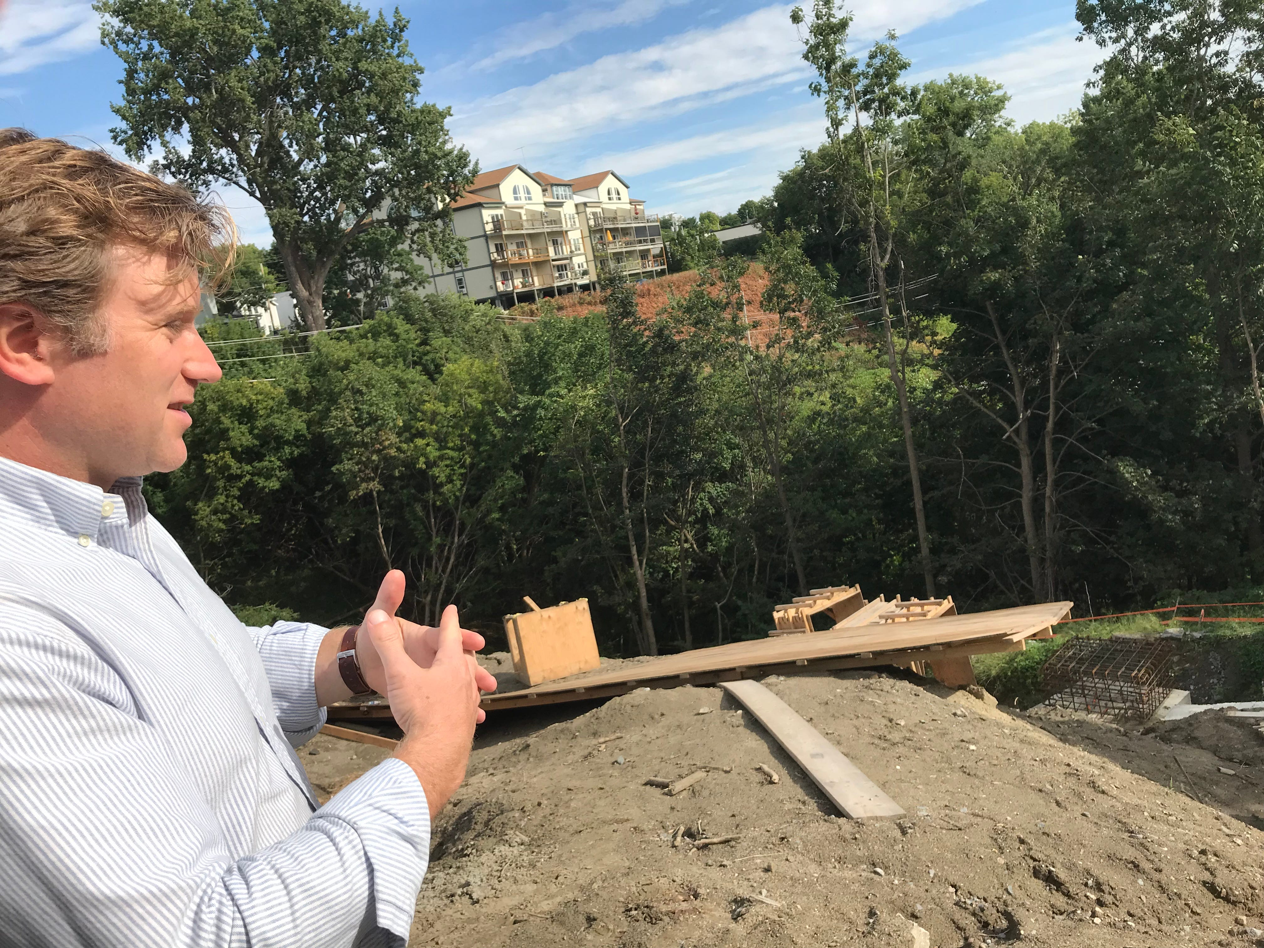 Dan Goltzman, project manager for Burlington-based Redstone, describes construction challenges on a hillside overlooking Lake Champlain in Burlington on Sept. 6, 2018.