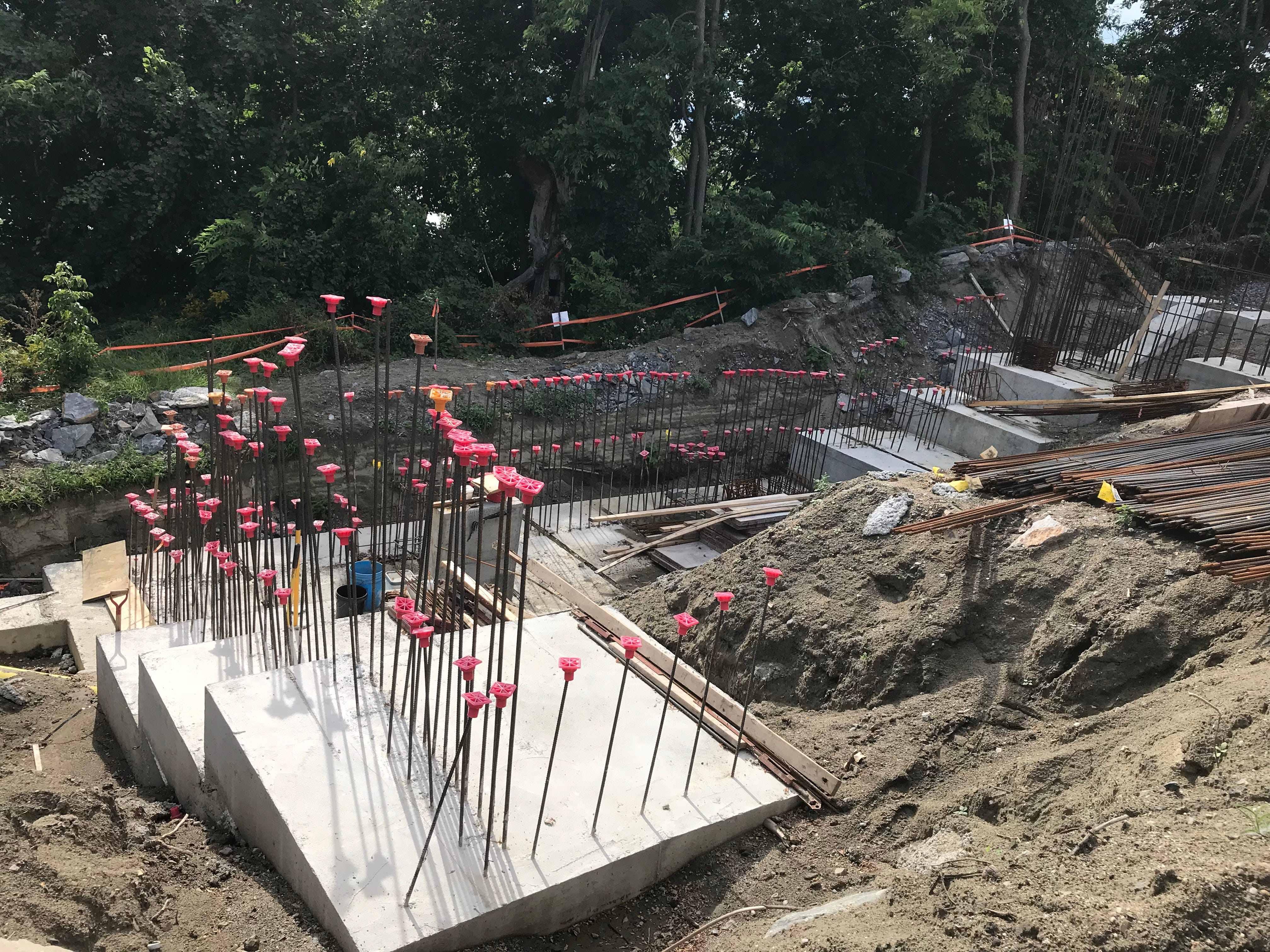 """Foundation slabs extend up a steep hillside overlooking Lake Champlain in Burlington, in preparation for the """"One Lakeview"""" apartment building on Sept. 6, 2018."""