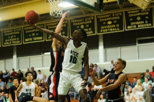 Rice's Leo Chaikin (10) Leaps for a lay up during the boys basketball game between the Rutland Raiders and the Rice Green Knights at Rice Memorial High School on Monday night December 17, 2018 in South Burlington.