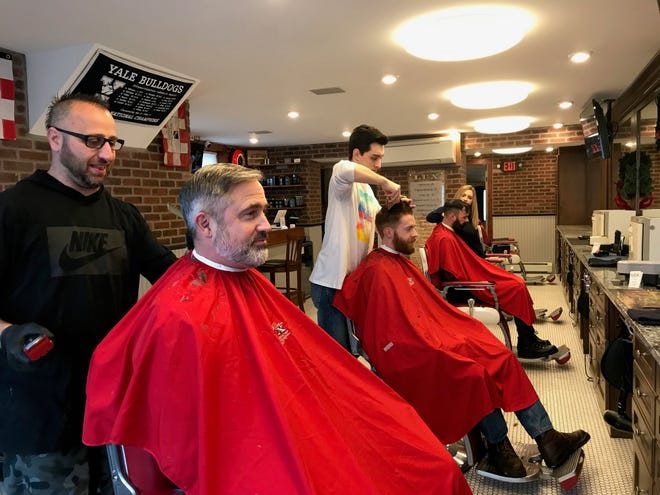 All three barbers at LUX have clients in their seats, Dec. 5, 2018.