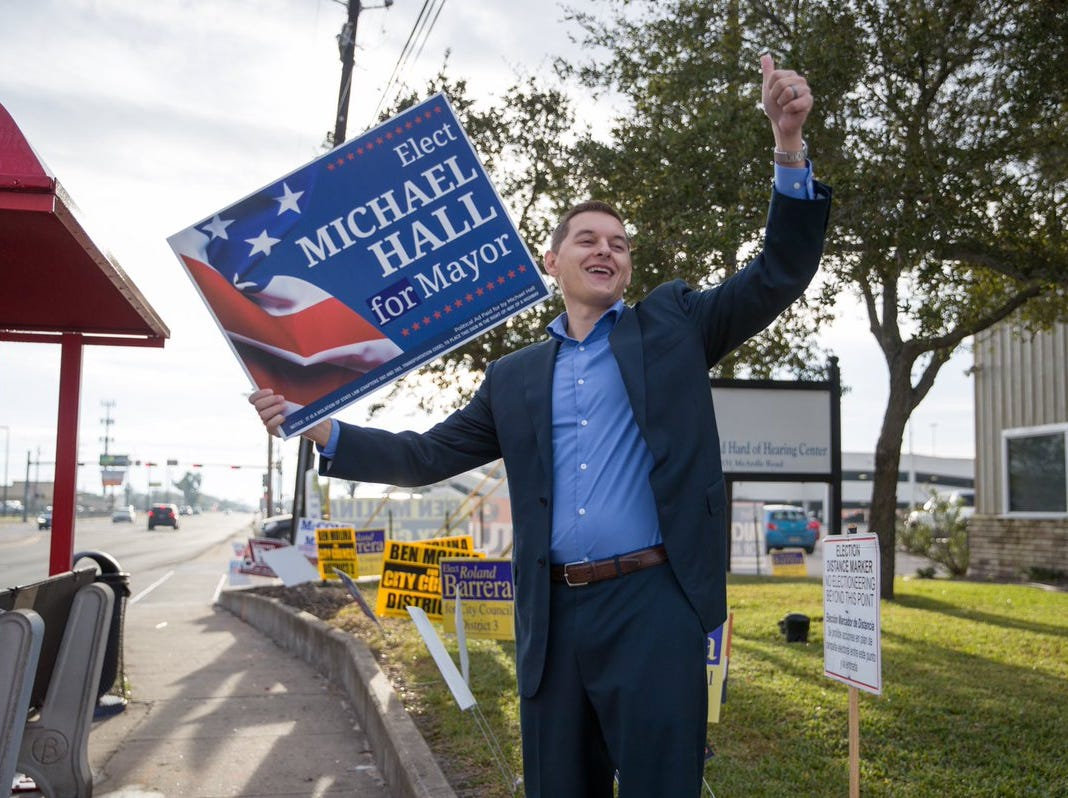 Michael Hall, candidate for Corpus Christi mayor, campaigns on Tuesday, Dec. 18, 2018, outside the Deaf & Hard of Hearing Center.