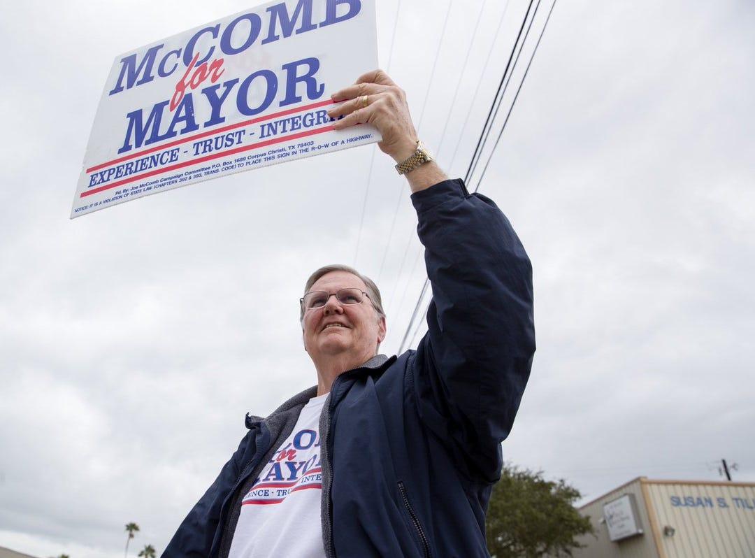 Corpus Christi Mayor Joe McComb campaigns outside the Deaf & Hard of Hearing Center on Tuesday, Dec. 18, 2018.