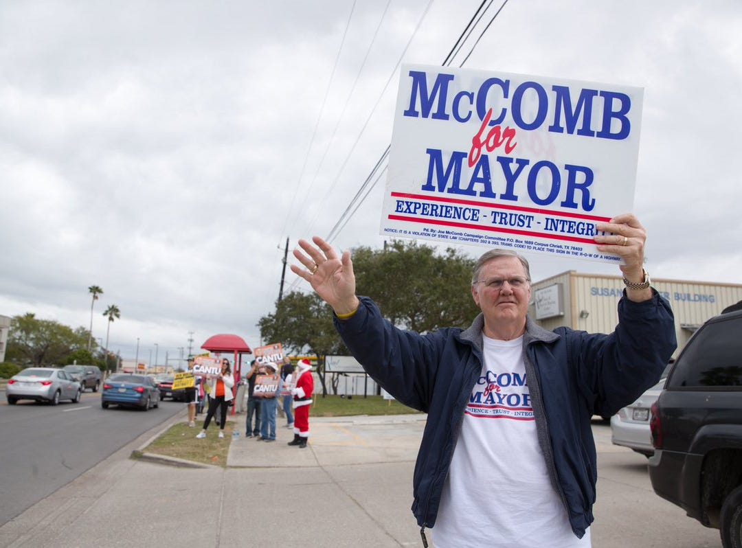 Corpus Christi Mayor Joe McComb campaigns outside the Deaf & Hard of Hearing Center on Tuesday, Dec. 18, 2018.