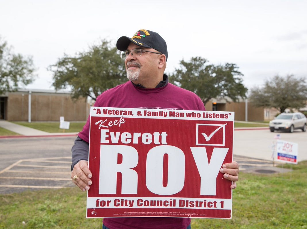District 1 Councilman Everett Roy campaigns on Tuesday, Dec. 18, 2018  outside Magee Elementary School.