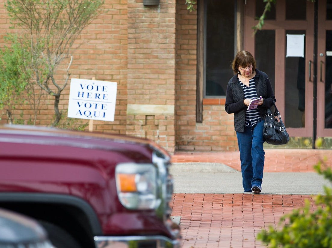 A voter leaves Grace Presbyterian Church after voting in the Corpus Christi City Council runoffs on Tuesday, Dec. 18, 2018.