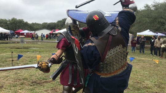Shire of Seawinds member Robert Howsmon, known as Marcus Cassius Maximus, (left) scrimmages with member Brian Griffith, also known as Brian McGregor of Argyll, at the 20th Ingleside Renaissance Festival.