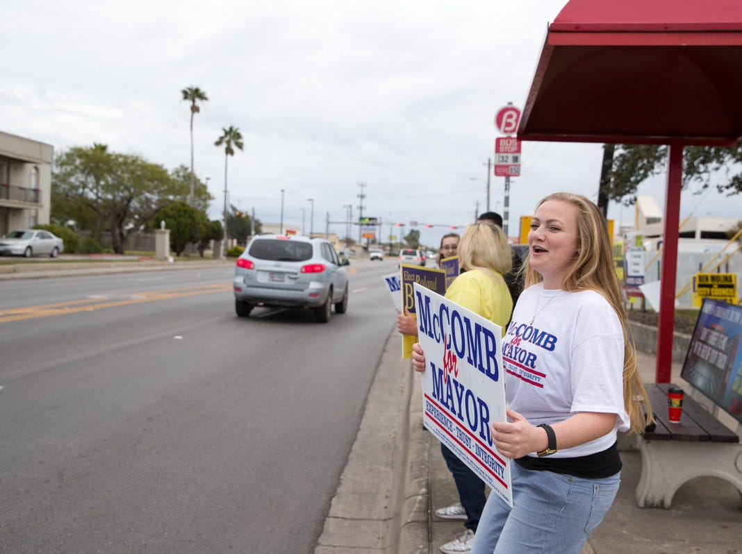 People campaign for Corpus Christi City City Council candidates on Tuesday, Dec. 18, 2018, outside the Deaf & Hard of Hearing Center.