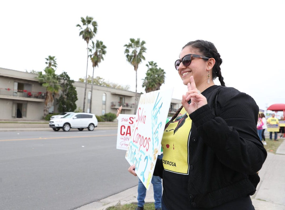 People campaign for Corpus Christi City Council candidates on Tuesday, Dec. 18, 2018, outside the Deaf & Hard of Hearing Center.