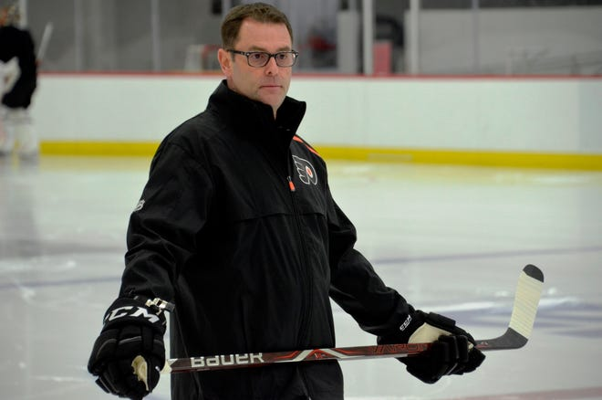 Scott Gordon took the ice with the Flyers for the first time as interim coach Tuesday before the game against the Detroit Red Wings.