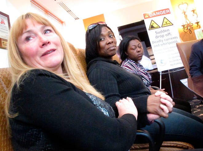From left, Sandra Smith, Tasha Hart and Domonique McNeil speak at a news conference in Egg Harbor Township about the drowning deaths of relatives at a beach in North Wildwood. On Tuesday, a judge dismissed Smith's lawsuit, ruling that New Jersey and North Wildwood are entitled to immunity because the land where the death occurred is unimproved public property. At least three people have died at that inlet in similar accidents.