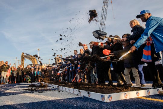 Participants break ground at the groundbreaking of FC Cincinnati's West End stadium on Tuesday, Dec. 18, 2018, in Cincinnati.