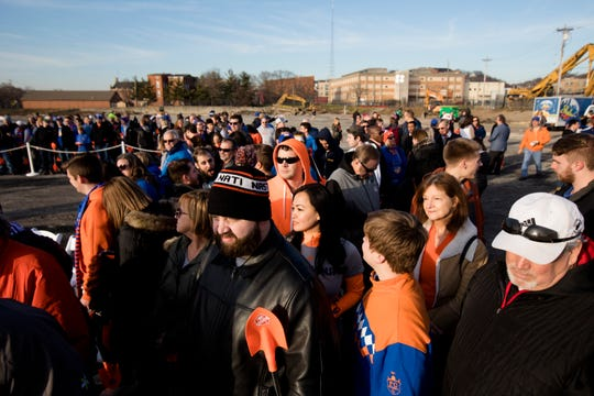 Fans listen to speakers at the groundbreaking of FC Cincinnati's West End stadium on Tuesday, Dec. 18, 2018, in Cincinnati.