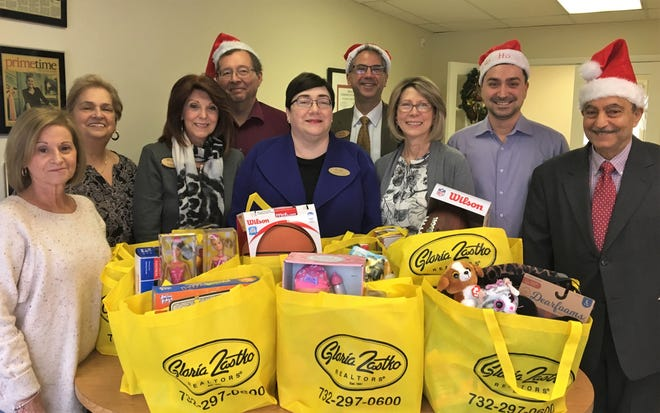 Agents at Gloria Zastko, Realtors, collected toys, sports equipment and other gifts for the clients of Women Aware to use as holiday gifts for their families this year.