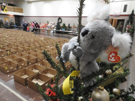 Twenty decorated Christmas trees from a contest by Our Town Coshocton were given out along with food boxes and Angel Tree donations on Wednesday at the Coshocton Salvation Army. Boxes were packed on Tuesday by volunteers.