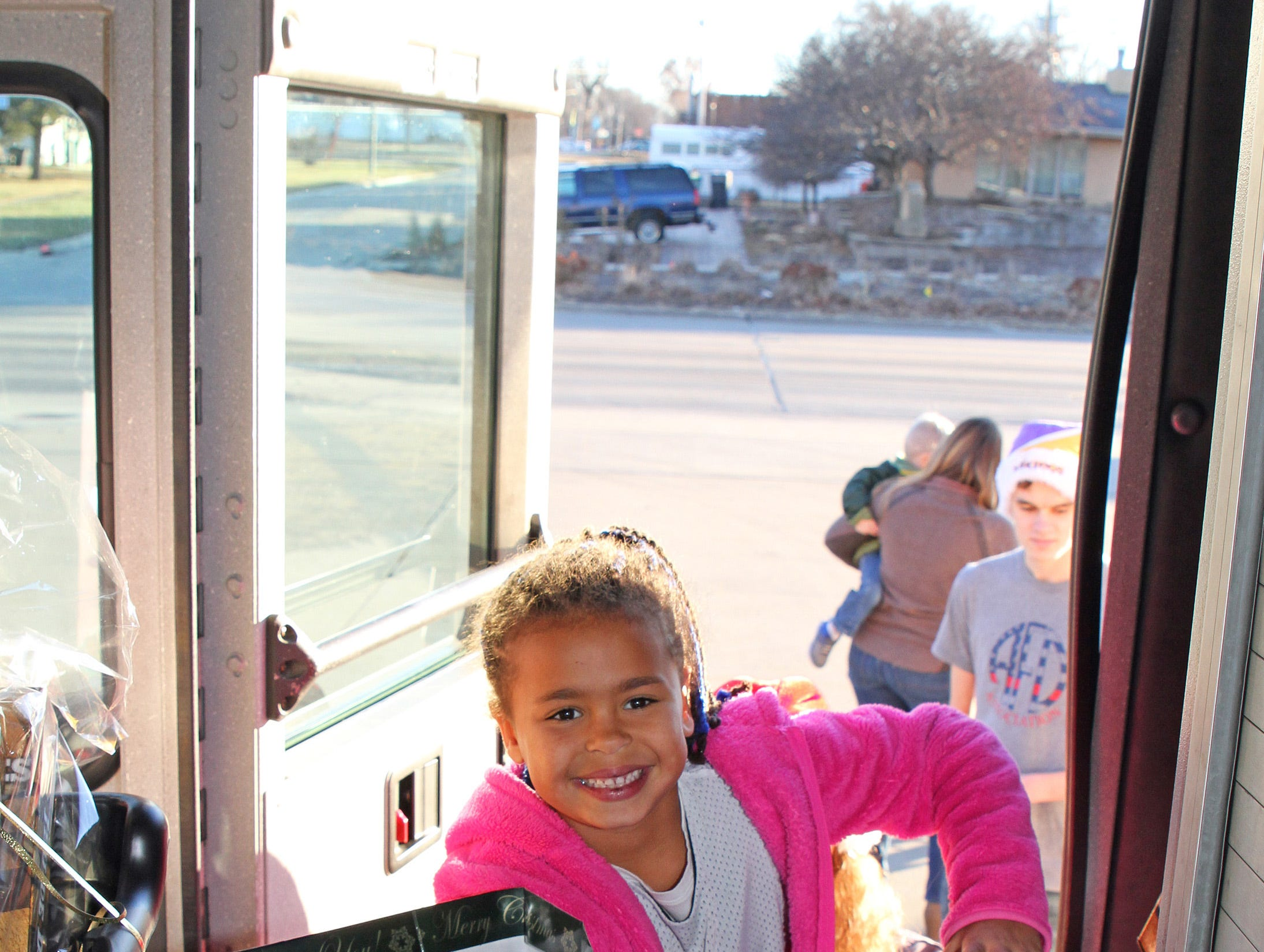 Saylor Horsley, 7, of Ankeny adds to the collection as gifts are dropped off at Ankeny's fill the truck day during the U.S. Marine Corps Toys for Tots campaign at the Ankeny Fire Station Headquarters on Sunday, Dec. 16, 2018.
