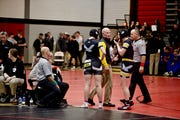 Waverly-Shell Rock assistant coach Josh Meier talks with members of the Go-Hawk girls' wrestling team at the Don Miller Invitational at Fort Dodge Senior High School on Saturday, Dec. 15, 2018. More than 20 girls' wrestlers participated in a girls' wrestling division.