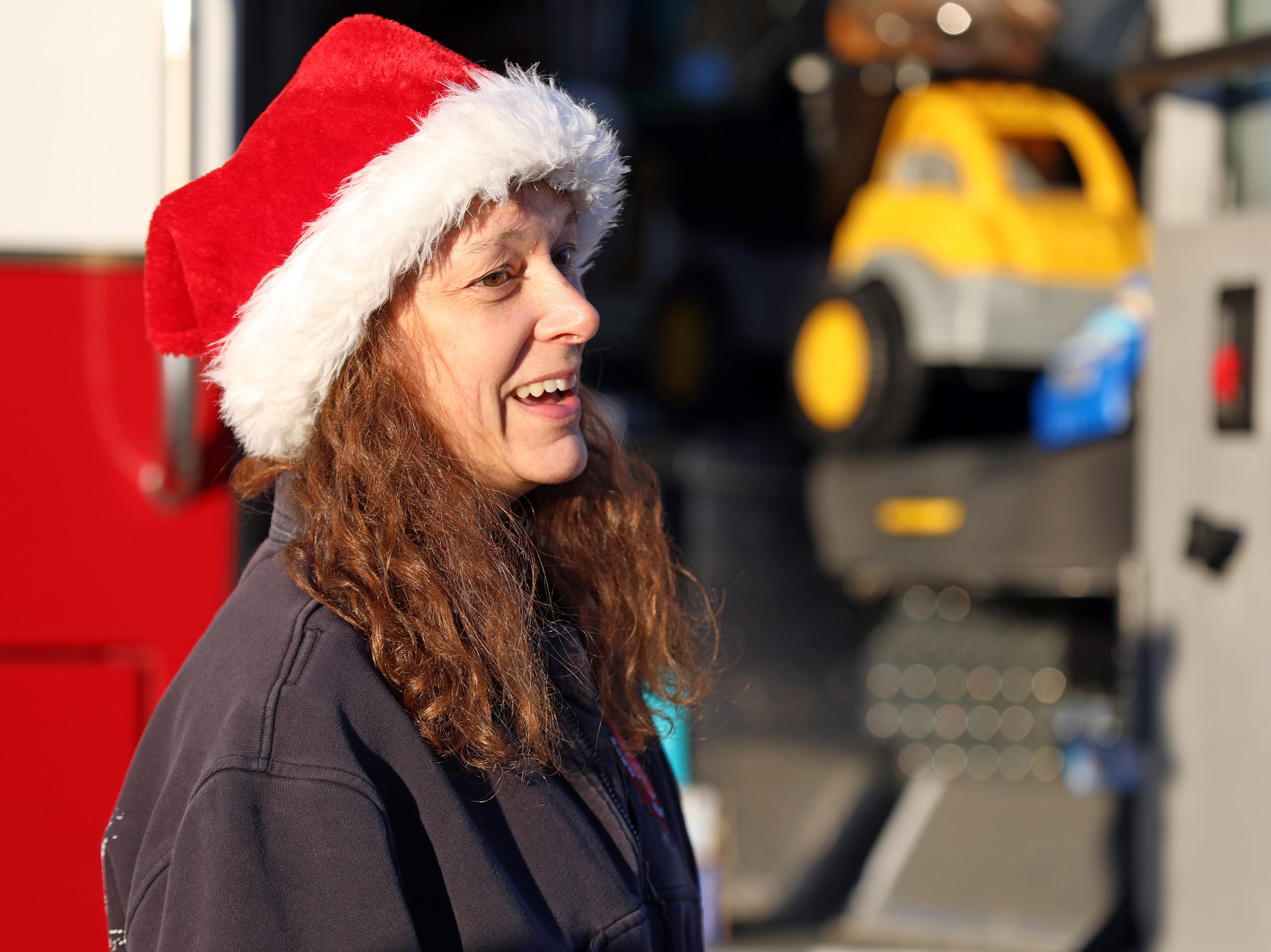 Karen Peters of the Ankeny Fire Department helps out as gifts are dropped off at Ankeny's fill the truck day during the U.S. Marine Corps Toys for Tots campaign at the Ankeny Fire Station Headquarters on Sunday, Dec. 16, 2018.