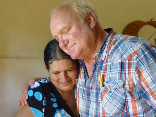 Former Register farm editor Jerry Perkins visits with Nicaraguan woman Adilia, who he met in the early 1970s.